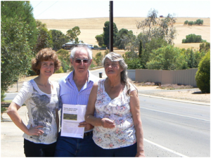 Tom Matthews, centre, (President of the Community Alliance SA) with Helen Wilmore, left, and Shirley Humphrey, right, of the Gawler Region Community Forum, on Cheek Avenue in Gawler East, with Concordia land in the background earmarked for future residential development. Photo by Stephen Williams, 21st Dec 2012